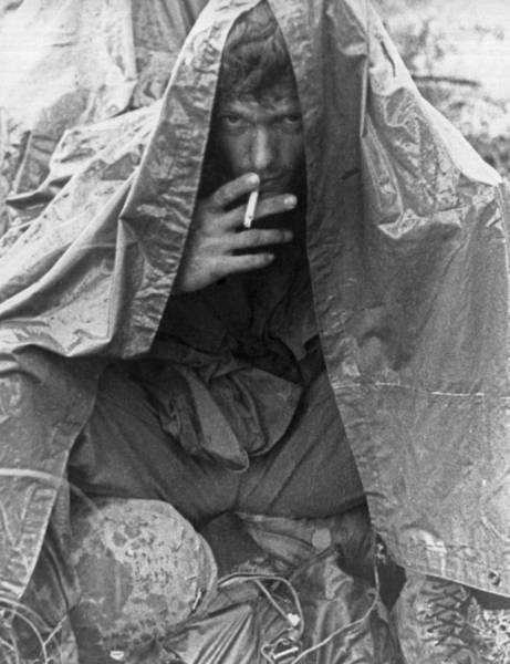 Poncho Wall Art - Photograph - Soggy Soldier In Vietnam by Underwood Archives