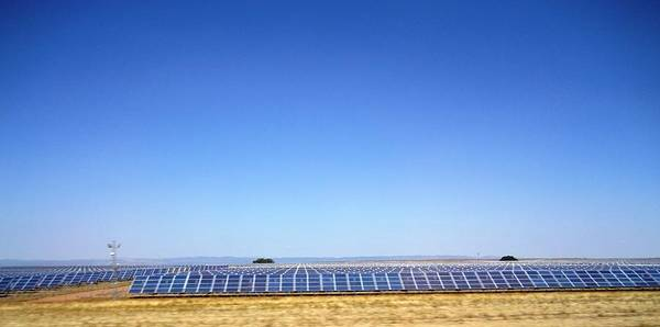 Photograph - Solar Panel Farm On The Way To Seville From Cordoba Spain by John Shiron