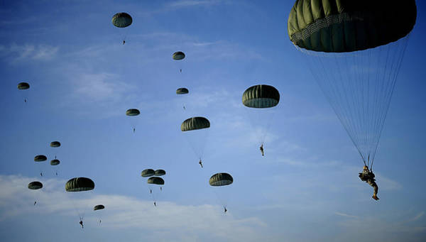 Skydiver Photograph - Soldiers Descend Under A Parachute by Stocktrek Images