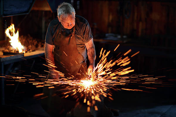 Forge Wall Art - Photograph - Sparks When Blacksmith Hit Hot Iron by Johan Swanepoel