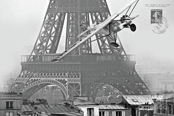 Roosevelt Island Wall Art - Mixed Media - Spirit Of St. Louis Flies Past The Eiffel Tower Art Print by Thomas Pollart