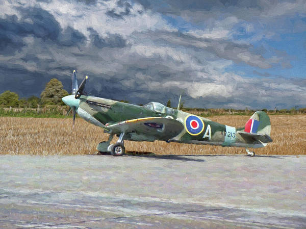 Photograph - Spitfire Under Storm Clouds by Paul Gulliver