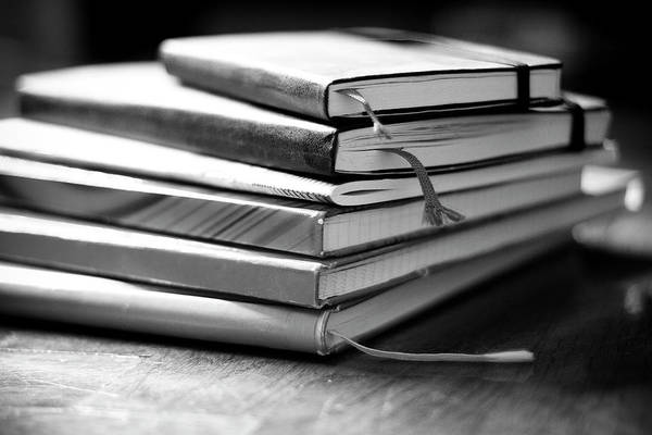 Wall Art - Photograph - Stack Of Notebooks by FOTOGRAFIE melaniejoos