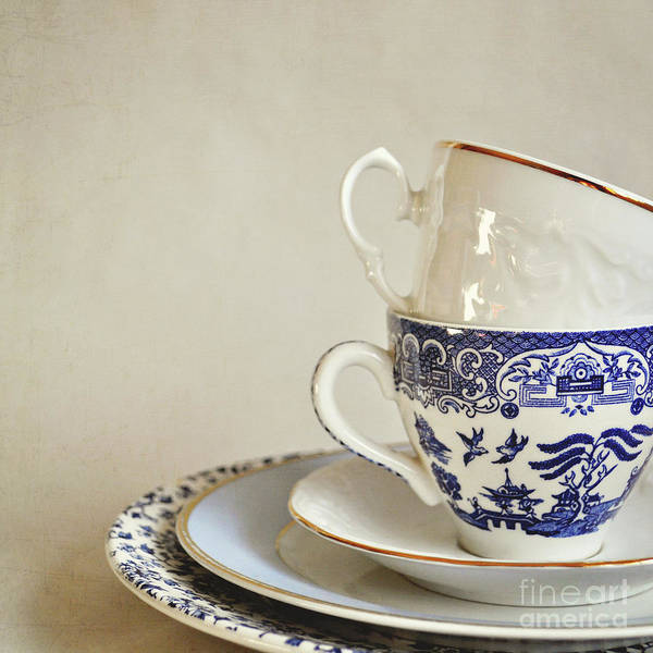 Wall Art - Photograph - Stacked Blue And White China Cups And Saucers. by Lyn Randle