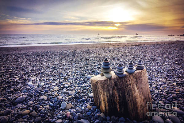 Beaches Photograph - Stacked Rocks At Sunset by Joan McCool