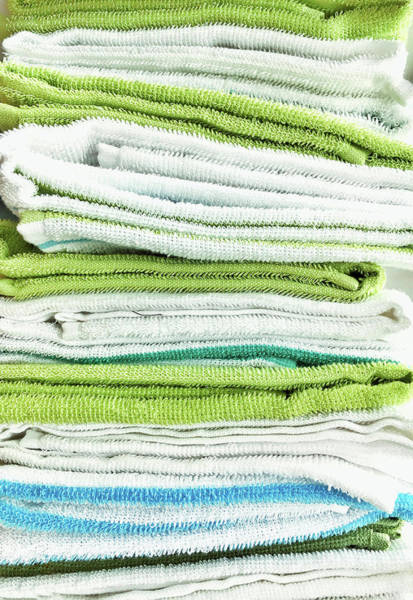 Checker Photograph - Stacked Tea Towels by Tom Gowanlock