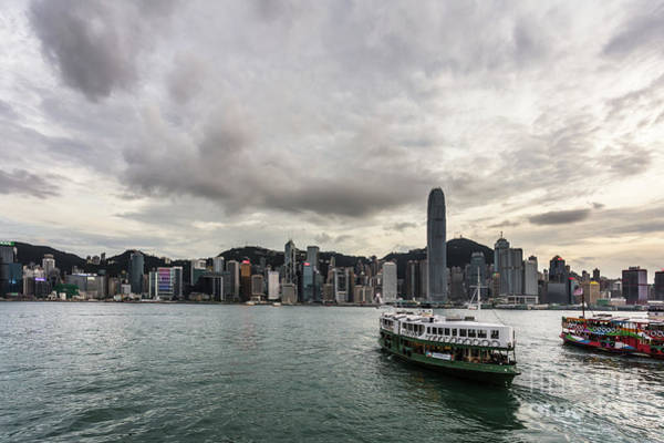 Photograph - Star Ferry Between Kowloon And Hong Kong Island During Sunset by Didier Marti