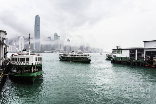 Photograph - Star Ferry On A Cloudy Sky With The Famous Skyline In Hong Kong. by Didier Marti