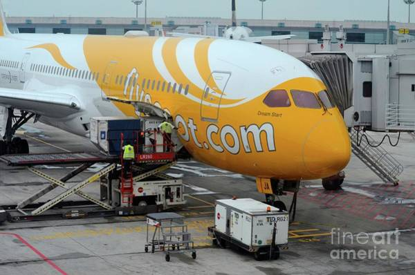 Photograph - Stationary Scoot Airline Airplane Serviced On Changi Airport Tarmac Singapore by Imran Ahmed