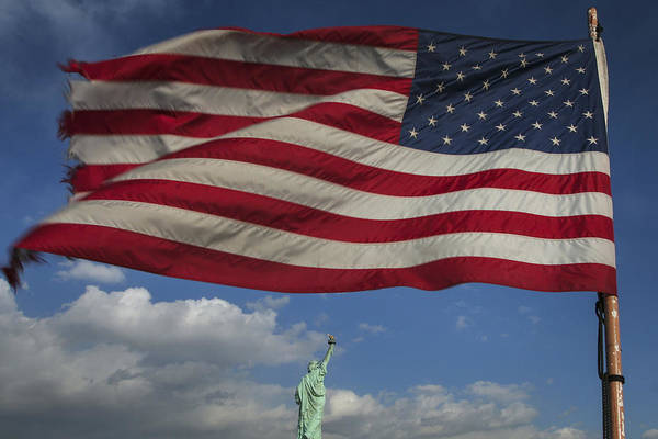 Photograph - Statue Of Liberty Under The Flag by Jed Holtzman