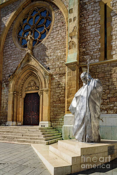 Photograph - Statue Of Pope John Paul II Statue In Front Of Sacred Heart Cathedral, Sarajevo by Global Light Photography - Nicole Leffer