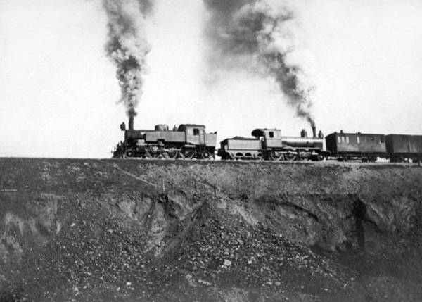 Pollution Photograph - Steam Engines Pulling A Train by Underwood Archives