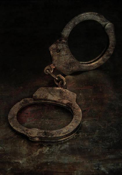 Photograph - Still Life With Old Rusty Handcuffs by Jaroslaw Blaminsky