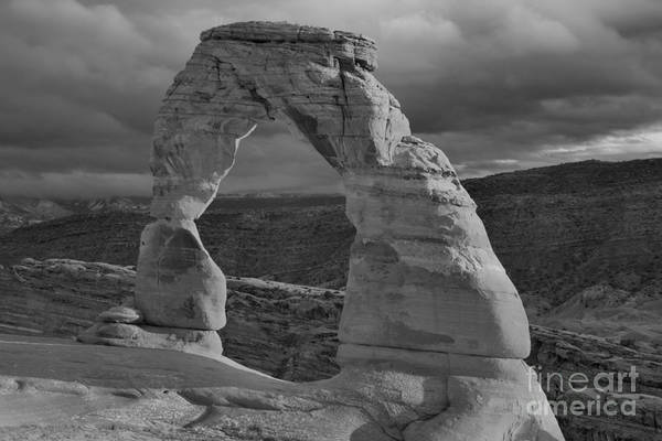 Photograph - Storm Clouds Over Delicate Arch Black And White by Adam Jewell