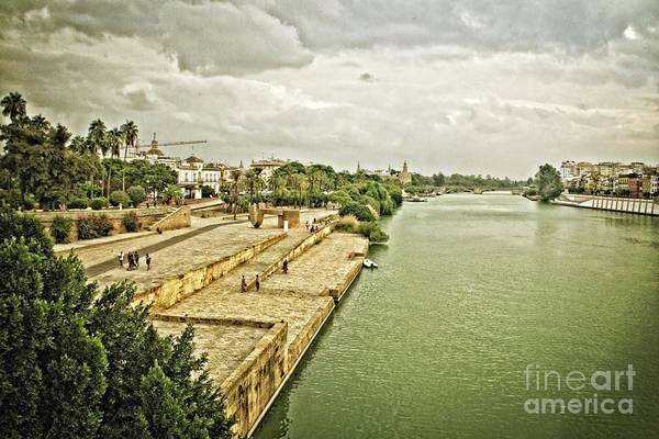 Wall Art - Photograph - Storm Clouds Over The Guadalquivir-seville by Mary Machare