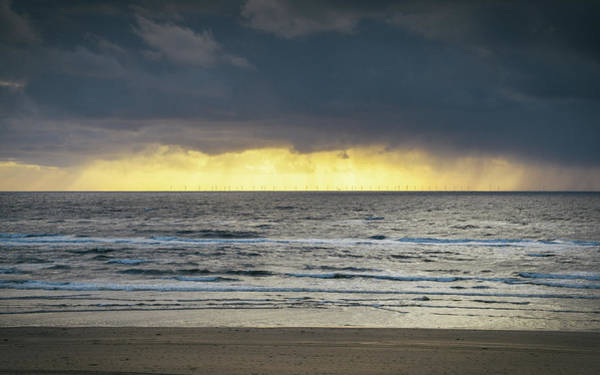 Photograph - Storm Clouds Overlooking Zandvoort In The Netherlands by Alexandre Rotenberg