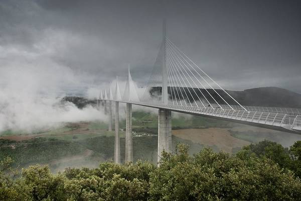 Photograph - Storm Clouds Roll In Over The Millau Viaduct by Stephen Taylor