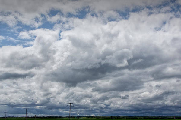 Photograph - Storm Clouds With Power Lines Over Farm Landscape In Saskatchewan Canada by Randall Nyhof