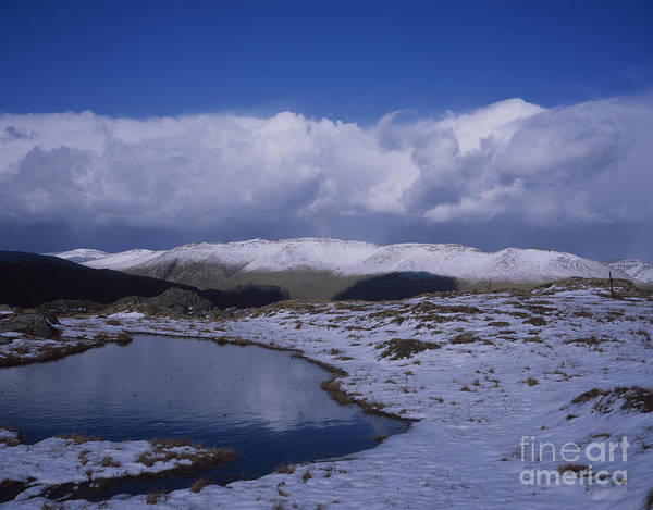 Grasmere Wall Art - Photograph - Storm  Shower Clouds Passing Over  Snow Capped Summit Of Helvellyn From Near Ash Crags  High Raise by Michael Walters