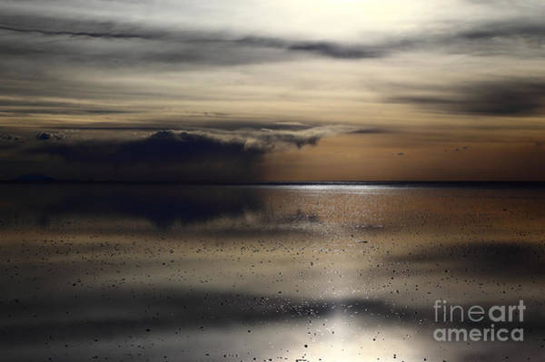 Photograph - Stormy Skies Over Salar De Uyuni Bolivia by James Brunker