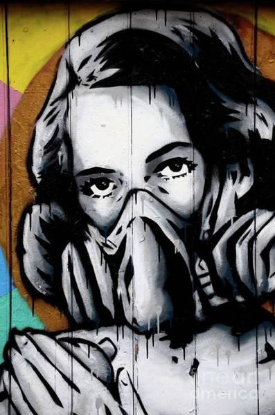 Photograph - Street Art Wall Mural Graffiti Of Woman Wearing Oxygen Gas Mask London England by Imran Ahmed