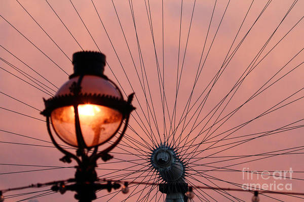 Photograph - Street Lamp And Spokes by James Brunker