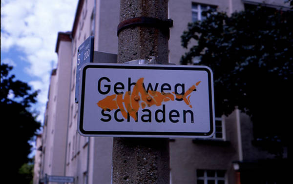 Photograph - Street Sign With Graffiti by Nacho Vega