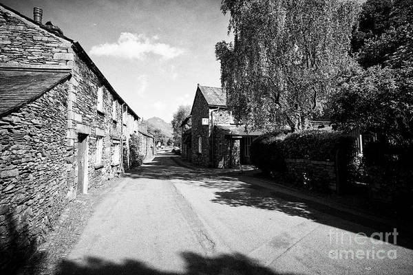 Grasmere Wall Art - Photograph - Street Through Traditional Lake Stone Slate Built Cottages In The Hamlet Of Town End Near Grasmere L by Joe Fox