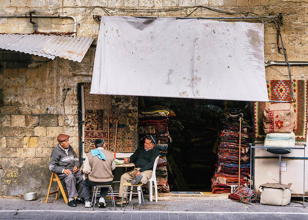 Photograph - Street Traders In Jaffa, Israel Relaxing by Alexandre Rotenberg