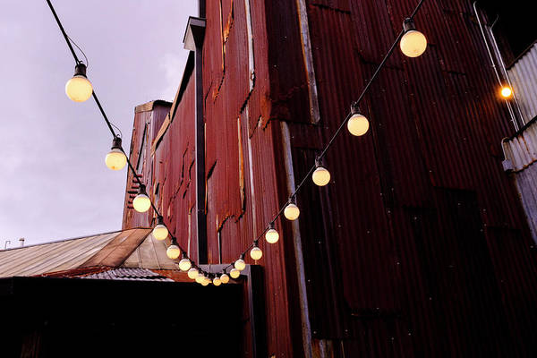 String Of Lights Near An Old Brown Building In Saint Augustine F Art Print