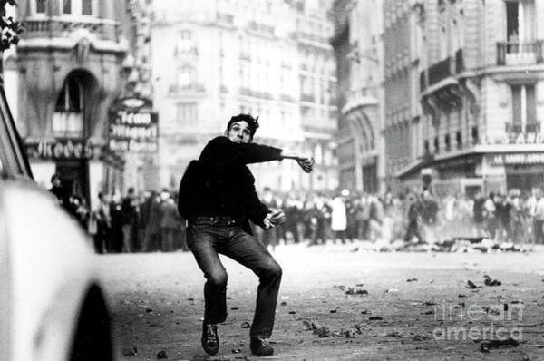 Turmoil Photograph - Student Throwing Cobblestones During Demonstration In Paris On May 25, 1968  by French School