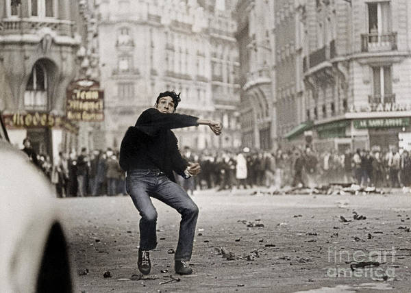 Turmoil Photograph - Student Throwing Stones During Demonstration In Paris On May 25, 1968 by French School
