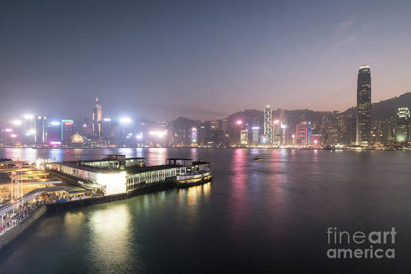 Photograph - Stunning View Of The Twilight Over The Victoria Harbor And Star  by Didier Marti
