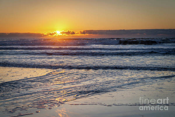 Sun Behind Clouds With Beach And Waves In The Foreground Art Print