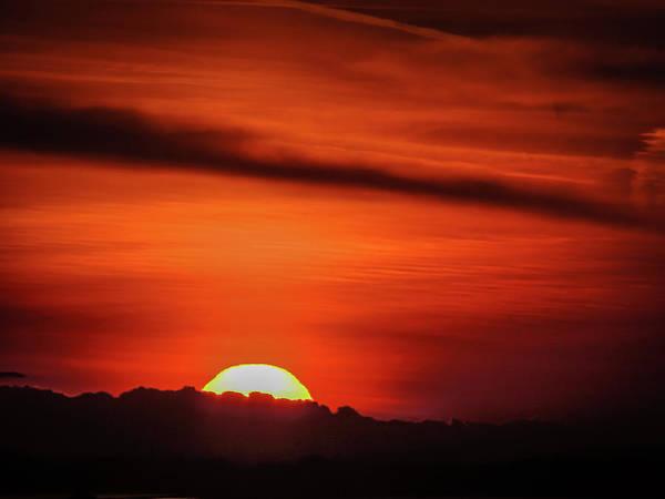 Photograph - Sun Rising Over Clouds by James Truett