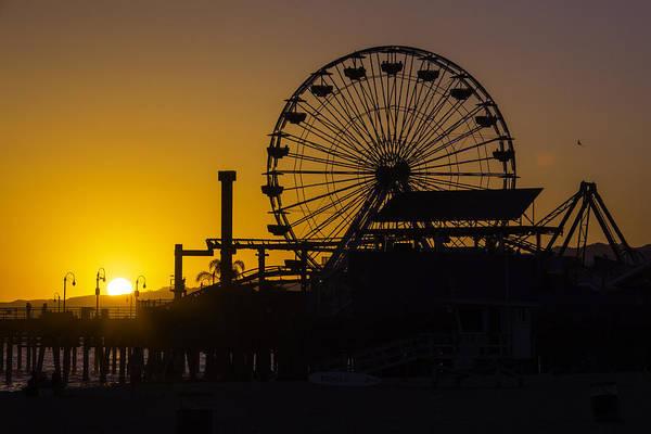 Ferris Wheel Photograph - Sun Setting Beyond Ferris Wheel by Garry Gay