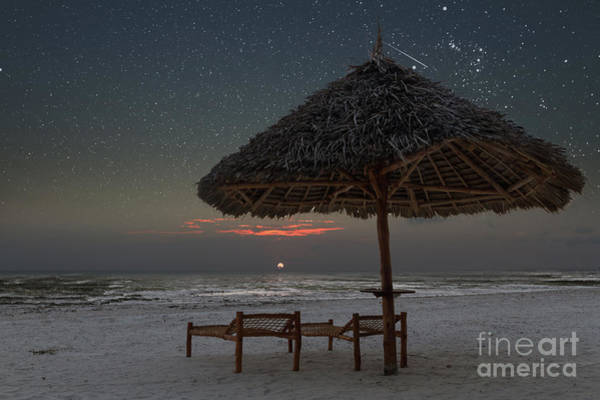 Photograph - Sunrise In Tropical Beach Of Zanzibar With Starry Sky by Pier Giorgio Mariani