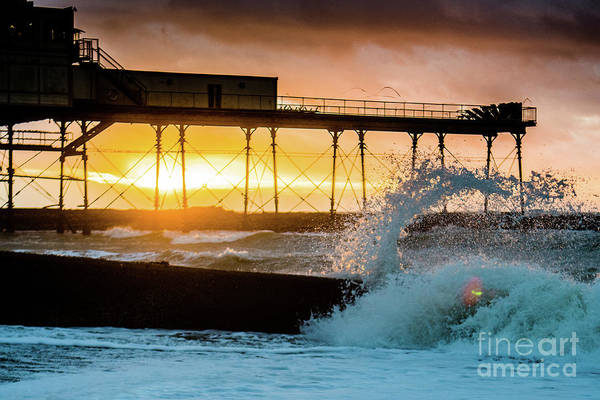 Photograph - Sunset And Spashing Waves In Aberystwyth by Keith Morris