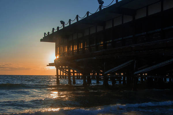 Photograph - Sunset At The Pier by Ed Clark