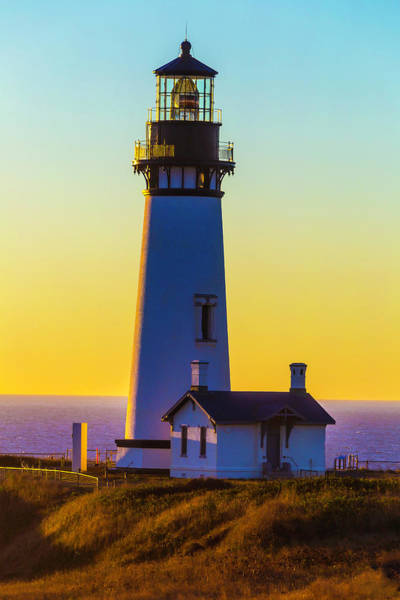 Fresnel Lens Wall Art - Photograph - Sunset At Yaquina Head Lighthouse by Garry Gay