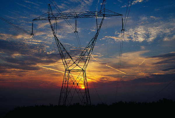 Juxtaposition Photograph - Sunset Behind High Tension Power Lines by Panoramic Images