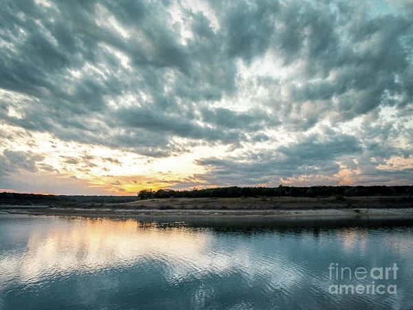 Sunset Behind Small Hill With Storm Clouds In The Sky Art Print
