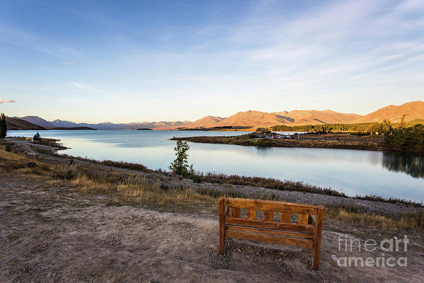 Photograph - Sunset Over A Bench Overlooking The Stunning Lake Tekapo In New  by Didier Marti