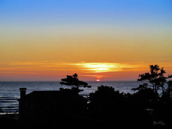 Photograph - Sunset Over Cannon Beach by Susan Molnar
