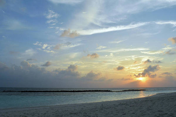 Photograph - Sunset Over The Sea In Maldives by Oana Unciuleanu