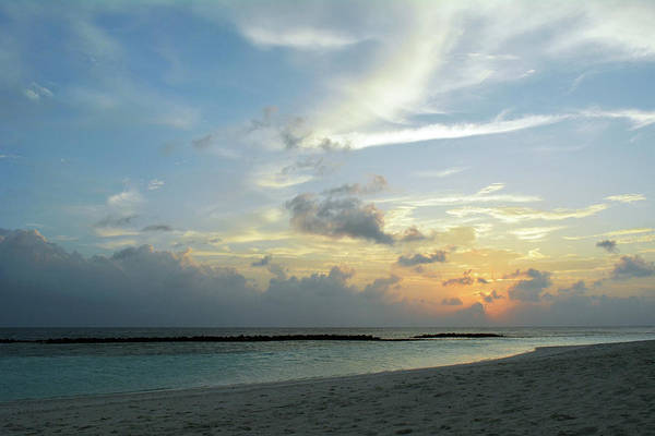 Photograph - Sunset Over The Water In Maldives With Cloudy Sky by Oana Unciuleanu