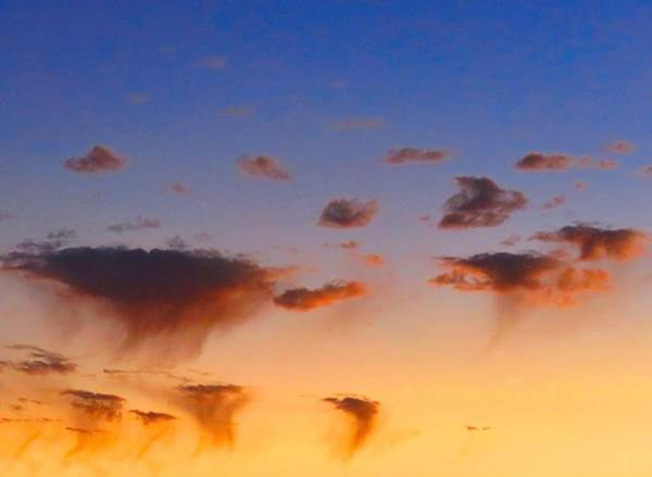 Photograph - Sunset Rain Clouds by Judy Kennedy