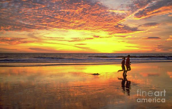 Disappearance Photograph - Sunset Ocean Runners by David Zanzinger