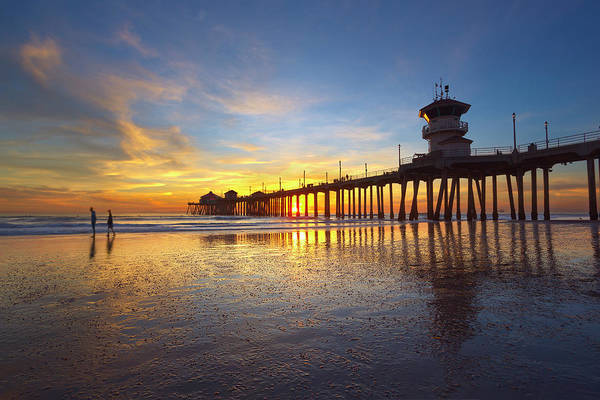 Huntington Beach Pier Photograph - Sunset Stroll by Brian Knott Photography