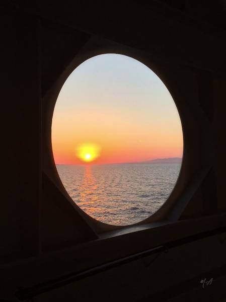 Photograph - Sunset Through A Porthole by Mark Taylor
